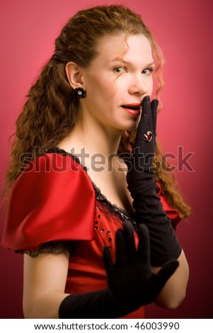 portrait of woman with a refusal expression on red background - stock photo
