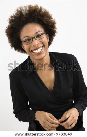 Portrait of woman with afro wearing eyeglasses against white background.