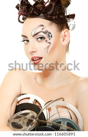 portrait of woman with beautiful art film movie make-up and hairstyle holding vintage spools isolated on white background - stock photo