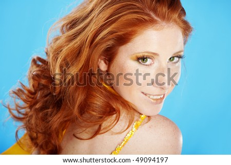 Portrait of woman with beautiful red hair - stock photo