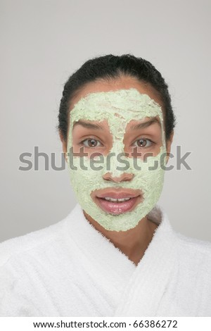 Portrait of woman with beauty mask on face - stock photo