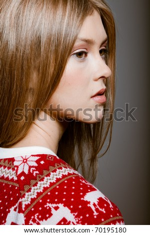 Portrait of woman with big eyes in a sweater