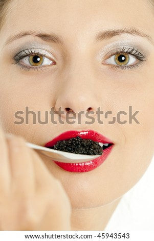 portrait of woman with black caviar