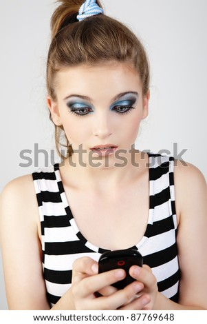 Portrait of woman with black phone. Girl texting with her phone. - stock photo
