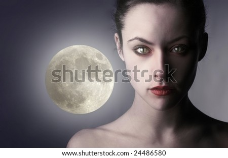 portrait of woman with cat's eye - stock photo
