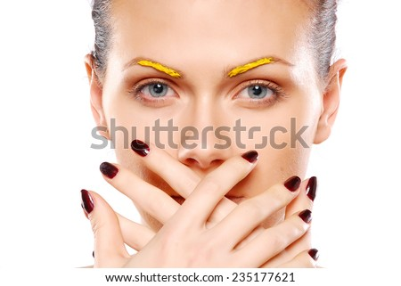 Portrait of woman with colorful eyebrush make-up - stock photo