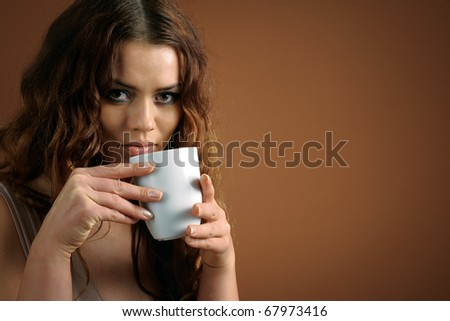 Portrait of woman with cup of coffee