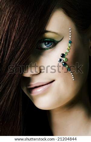 Portrait of woman with diamonds over the face