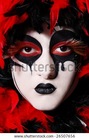 Portrait of woman with faceart like venetian mask - stock photo