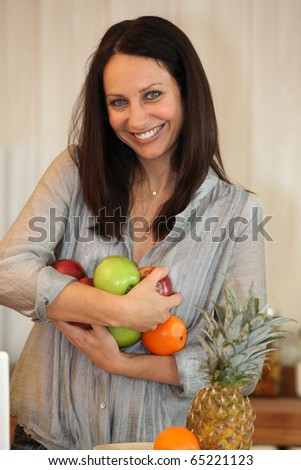 Portrait of woman with fruits