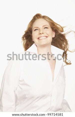 Portrait of woman with hair blowing - stock photo