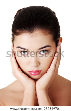Portrait of woman with hands on chin. - stock photo