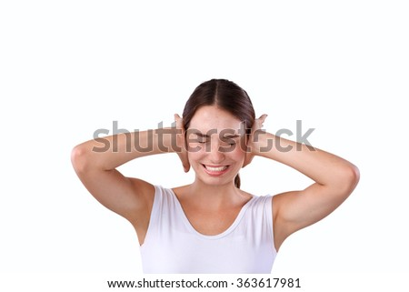 Portrait of woman with hands on ears - stock photo
