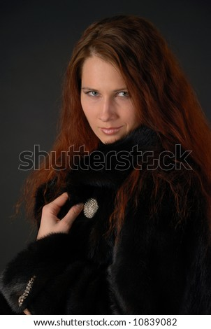 Portrait of woman with long hair in fur coat, pacific sight - stock photo