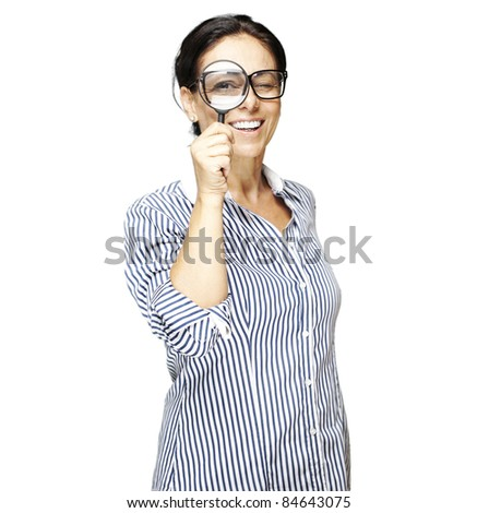 portrait of woman with looking through a magnifying glass against a white background