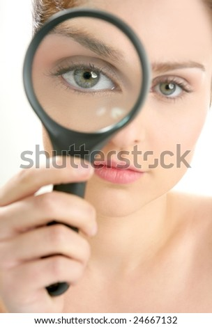 Portrait of woman with magnifier lens on eye isolated on white - stock photo