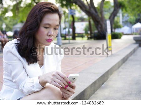 portrait of woman with mobile phone - stock photo