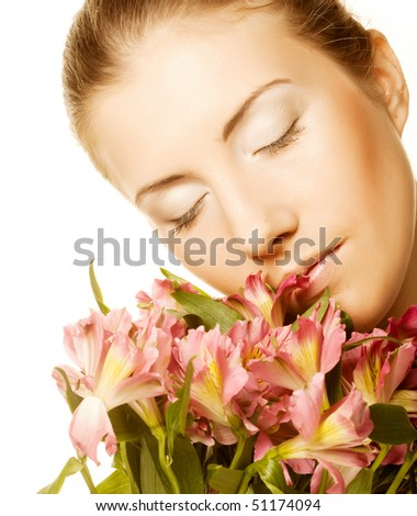 Portrait of woman with pink flowers