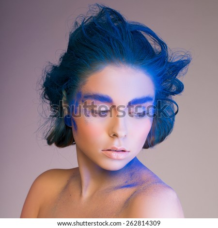 portrait of woman with powder on the eyebrows and face - stock photo