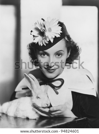 Portrait of woman with rabbit on Easter - stock photo