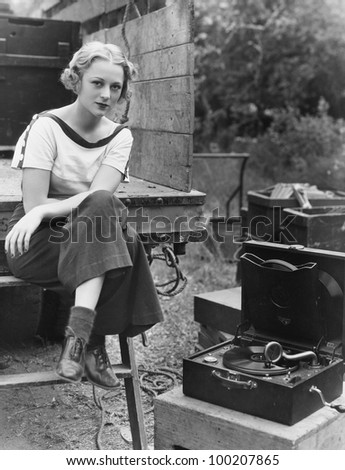 Portrait of woman with record player - stock photo
