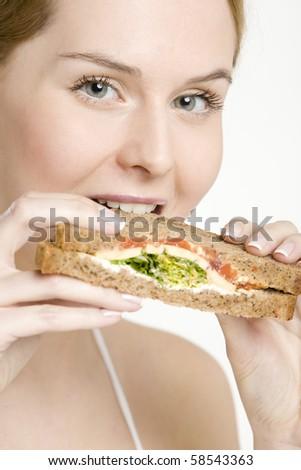 portrait of woman with sandwich - stock photo