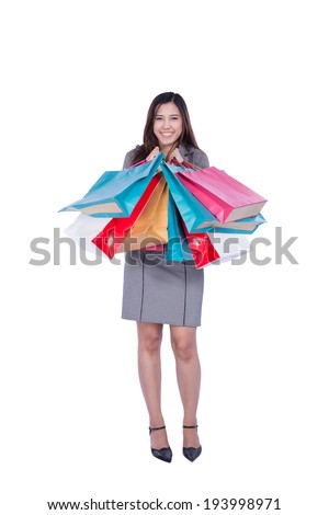 Portrait of woman with shopping bags, isolated over white background