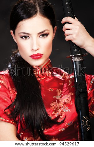 Portrait of woman with sword - stock photo