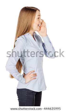 Portrait of woman woman loud screaming or calling out to someone. image on a white studio background. Negative human emotion expression and lifestyle concept