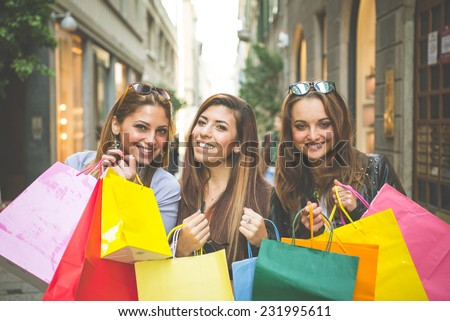 portrait of women holding shopping bags