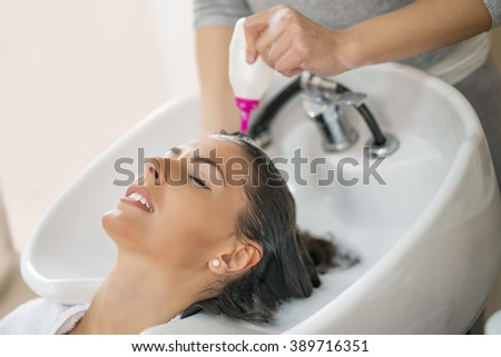 Portrait of women which wash hair in a beauty salon
