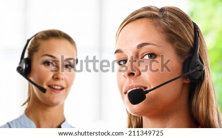 Portrait of women working in a call center - stock photo