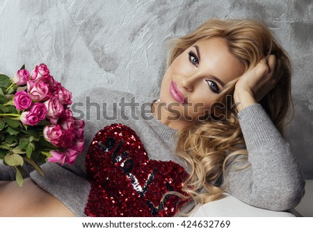 Portrait of wonderful young blonde woman with flowers - stock photo