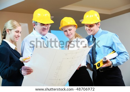 Portrait of worker group looking at new design project - stock photo