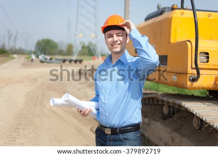 Portrait of worker in a construction site - stock photo