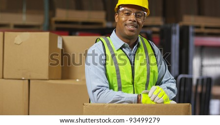 Portrait of worker in warehouse - stock photo