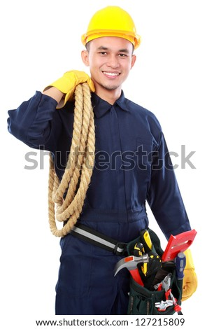 portrait of worker use blue uniform and belt tolls hold rope - stock photo