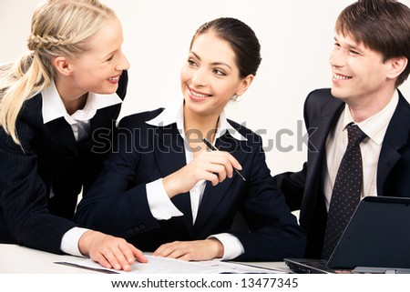 Portrait of working team discussing a new plan together