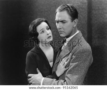 Portrait of worried couple - stock photo