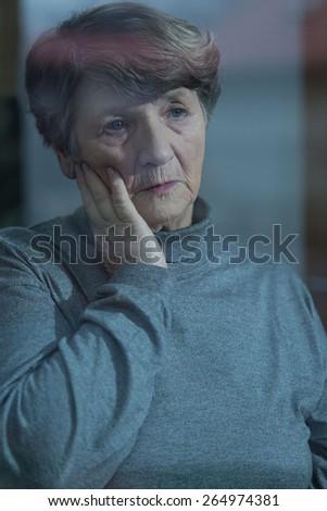 Portrait of worried resident of nursing home - stock photo