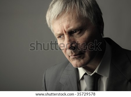 portrait of worried senior businessman