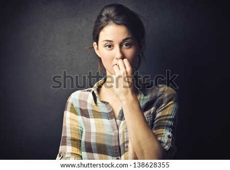 portrait of worried woman - stock photo