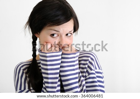 portrait of worried young woman on white background