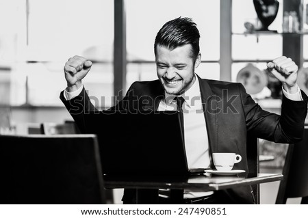 Portrait of yang confident businessman in interior black and white - stock photo