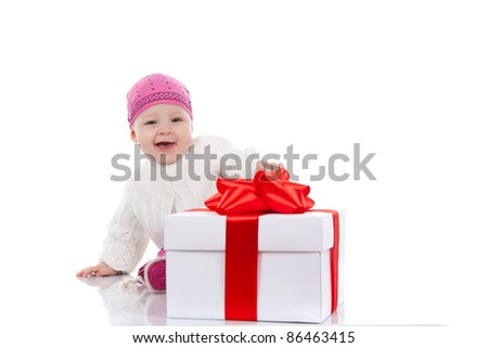 Portrait of 1 year child with gift box over white background studio