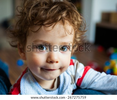 Portrait of 1 year old baby boy at home.