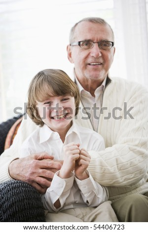 Portrait of 9 year old boy with grandfather - stock photo