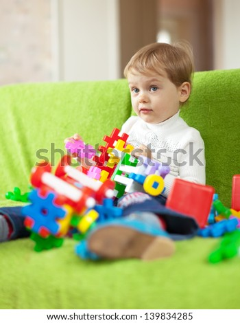 Portrait of 3 years child in home interior - stock photo