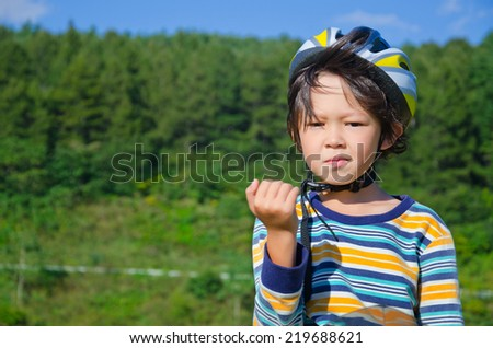 Portrait of 8 years old boy riding a bike - stock photo