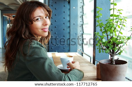 Portrait of 25-years-old girl with cup of coffee - stock photo